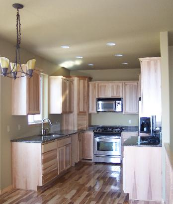 Kitchen w/ Hickory cabinets and flooring